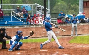 SAC FLY — Letcher Central senior Canaan Cunniff makes contact with the ball during a recent win over Shelby Valley. Cunniff hit into a sacrifice fly on this play, driving home the Cougars' first run of the 8-6 win. The Cougars held a 12-11 record on the season going into action Tuesday.
