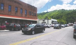 A first-call van was followed by numerous city vehicles as the body of late Whitesburg Mayor James Wiley Craft was driven past City Hall on Tuesday afternoon. (Photo by Sam Adams)