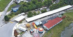 GETTING READY FOR FESTIVAL — Tents were erected, food booths were being moved into place, and the carnival was setting up when this photo of Mountain Heritage Village in downtown Whitesburg was taken by drone Tuesday afternoon. (Photo courtesy LCDpodcast)