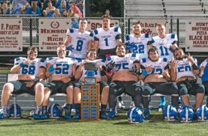 Members of the Letcher Central offensive line pose for a photo with the Friends of Coal Bowl trophy, which the Cougars successfully defended in Friday's victory over host Harlan County. Pictured are (back row, from left) Nicholas Haning, Carson Adams, Hayden Brashear and Isaac Matthews; front row, left to right, Hunter Hayes, Christian Griffith, Scott Pack, Tripp Stamper, Cody Combs and Dawson Cornett.