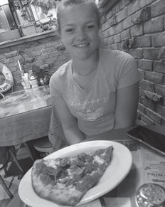 Katie Nottingham eats a slice of pizza while taking a tour of West Point in New York. Katie is a daughter of Scott and Anna Nottingham and granddaughter of Rose Ballard. Anna and Katie went from Toledo, Oh. to New York, then on to Maryland. They also took a hike on the Appalachian Trail.