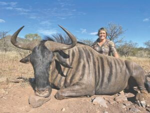"""Bridgette Holbrook says the meat prepared from this Blue Wildebeest she killed in South Africa """"is the best meat I have ever eaten."""""""